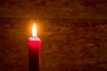flame on a red candle