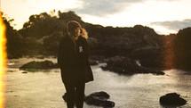 A girl prays outdoors