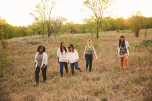 field, walking, friends, friendship, African American, woman, standing, together, outdoors, young women