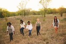 friends walking outdoors in a field