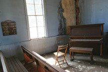 piano in the corner of an old church