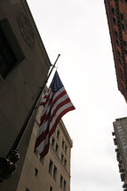 American flag on the side of a city building