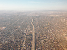 aerial view over a highway and suburbs