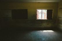 Open window in an empty room.