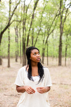 portrait of an African American woman standing outdoors