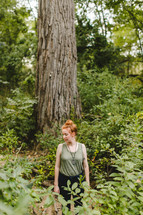 woman standing alone in a forest