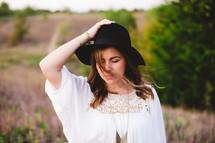 posing, woman, portrait, hat, outdoors, linen shirt