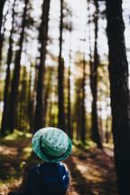 a boy walking in a forest