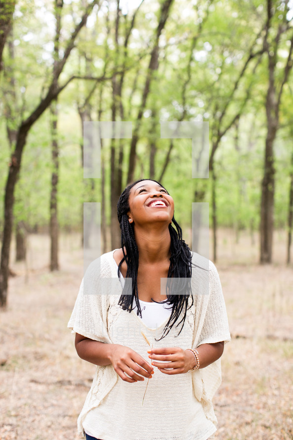 African American woman looking up to God