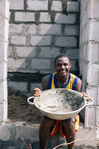 man holding a large bowl in Nigeria
