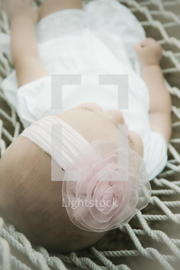 Infant lying in hamock