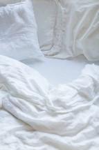 unmade bed sheets