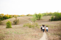 friends walking up a path on a hill