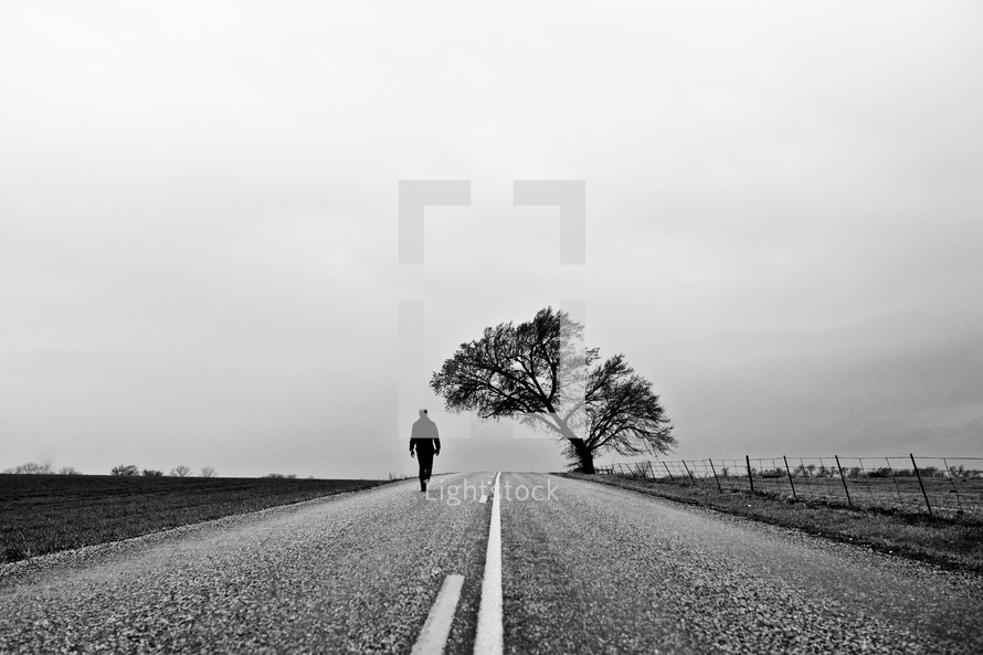 man walking down a road