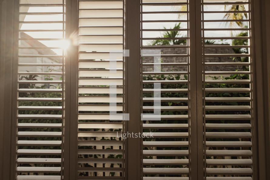 sunlight through shutters