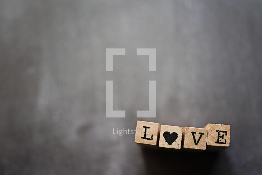 word love on wood block