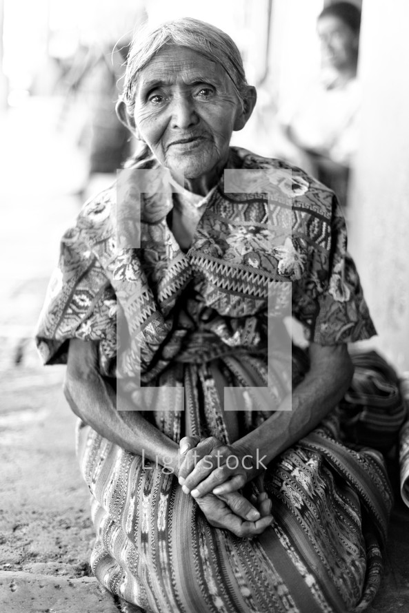 Elderly woman with folded arms