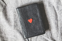 red heart on the cover of a Bible