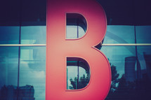 "Letter ""B"" of a neon sign on a building"