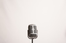 Retro microphone against a white background with copy space.