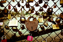 locks on a chain linked fence