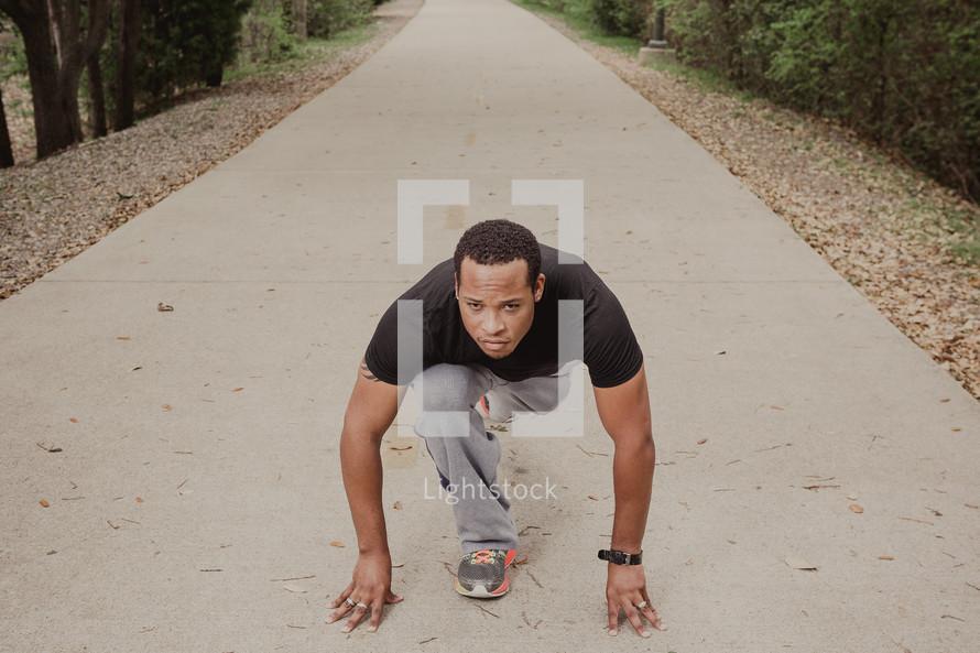 man stretching to run