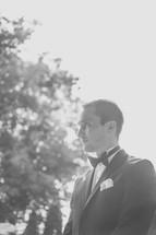 groom standing outdoors