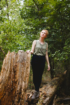 red head, bun, standing, forest, trees, outdoors