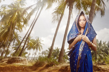Hindu woman under palm trees