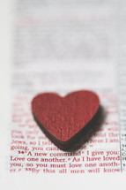 red heart shape on the pages of a Bible