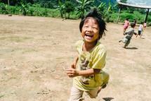 children running in the dirt