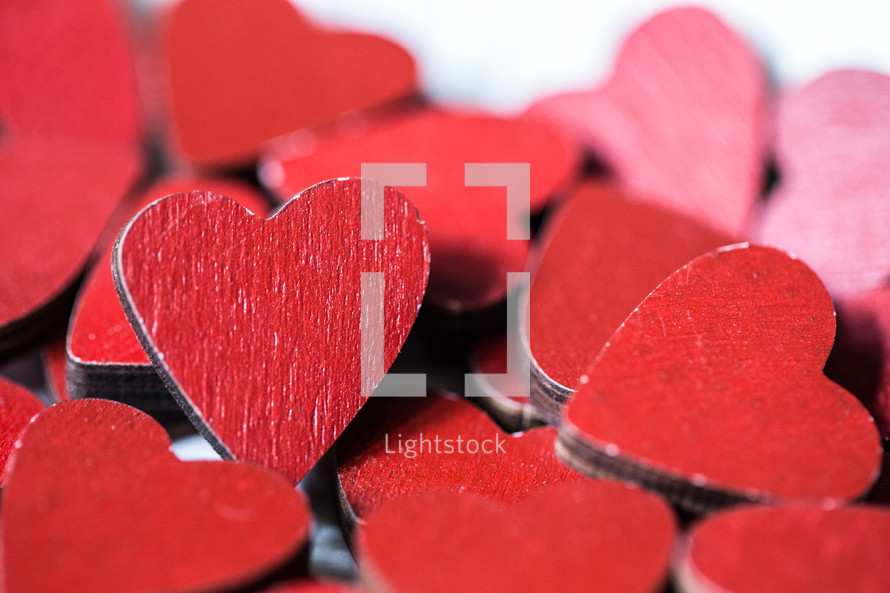 pile of red wooden hearts