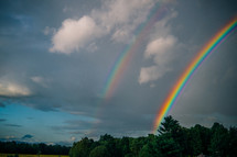 a double rainbow in the sky