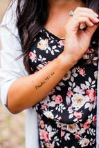 tattoo of Psalm 93:16 on a woman's arm