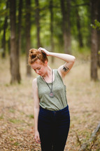 woman standing outdoors scratching her head
