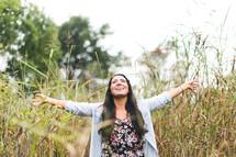 joyful woman with open arms