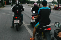 men on scooters and motorcycles