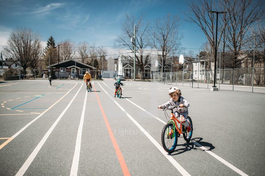 child riding a bike to school
