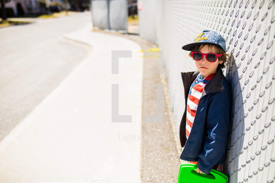 school boy waiting for the bus