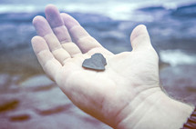 heart shaped rock in palm of the hand