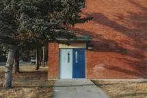 double doors to a brick building