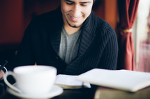 man reading a Bible at a bible study