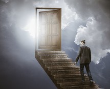 a man walking on steps to heaven