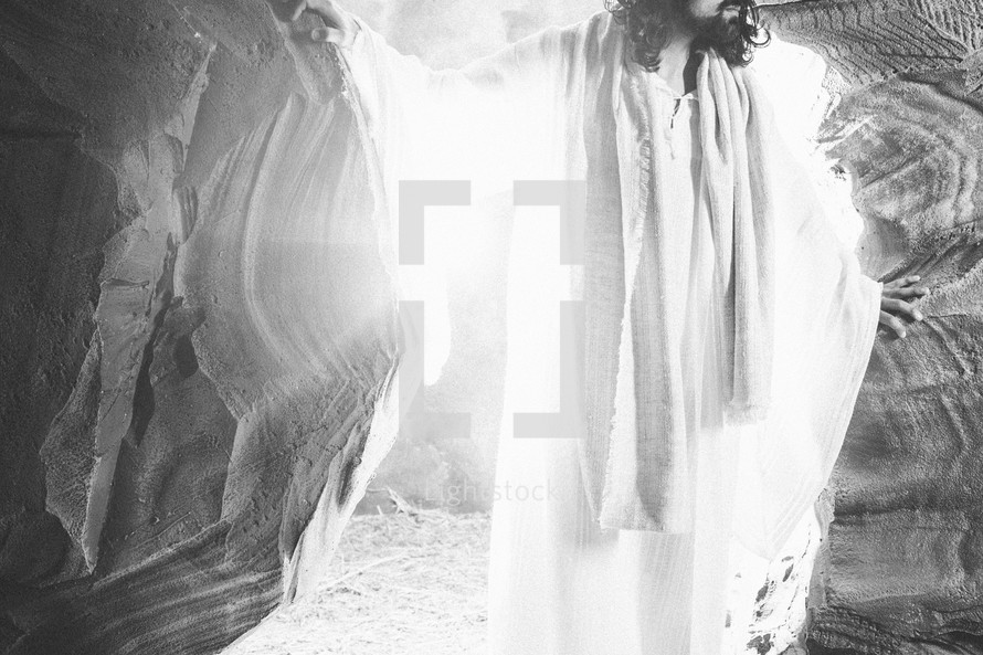 glow of light on Jesus as he stands at the entrance to his burial tomb