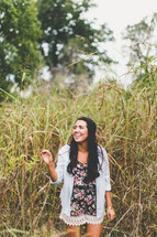 woman standing outdoors in tall grasses
