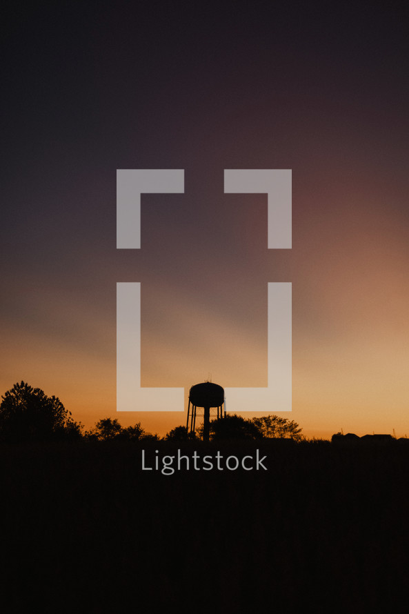 water tower silhouette at sunset