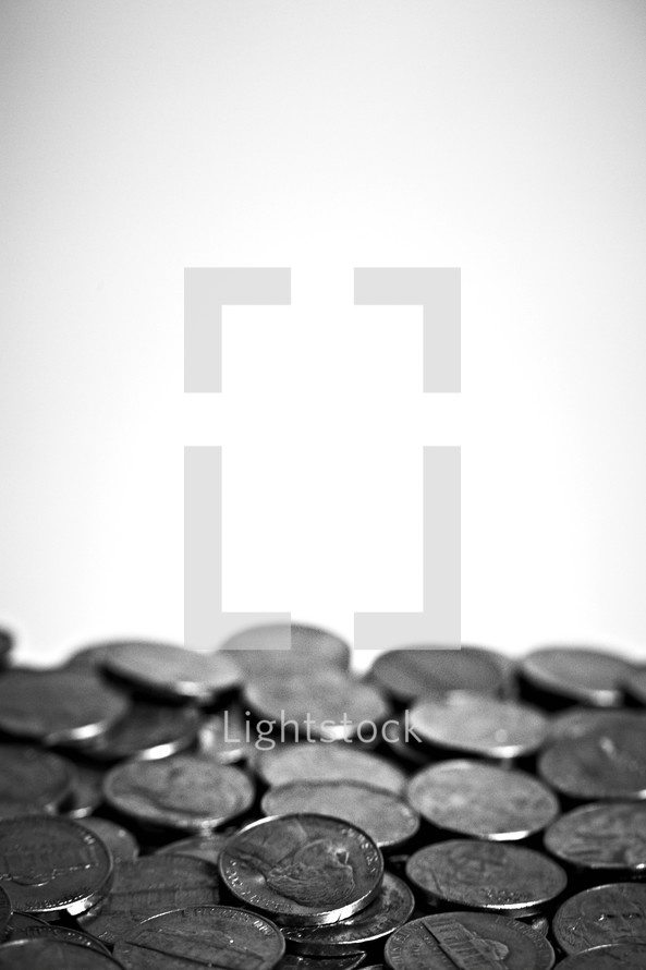 A cluster of nickels isolated on white
