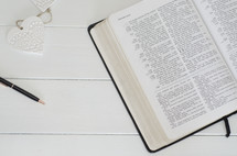 pen and open Bible