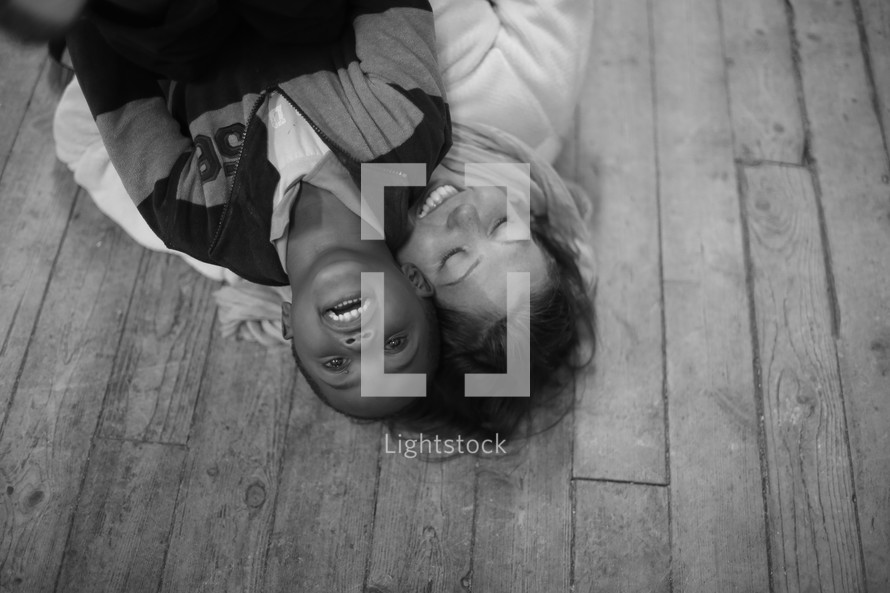 little boy and a woman playing on the floor