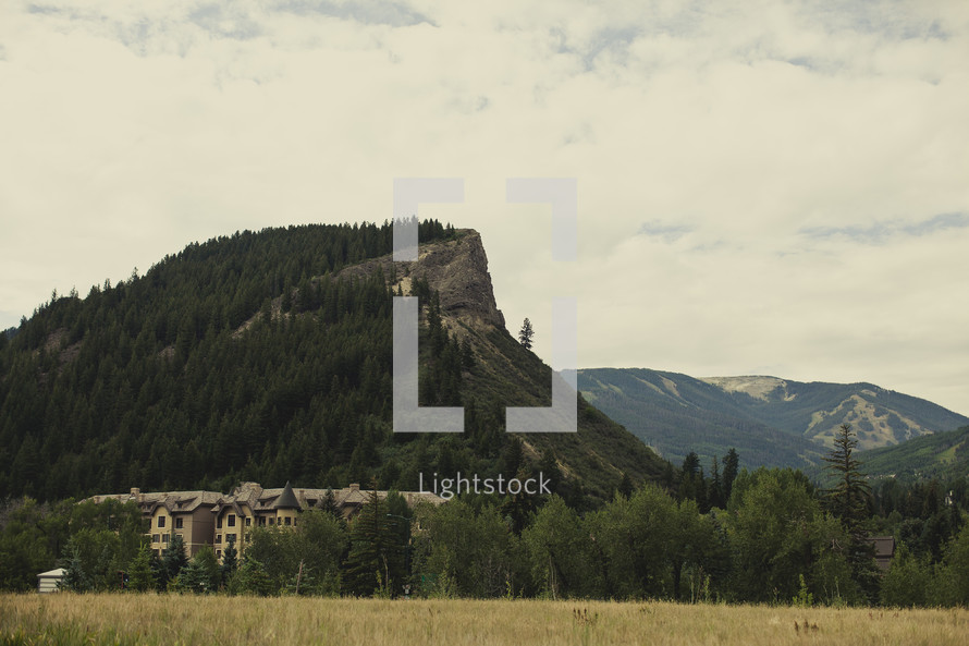 apartment building in front of a mountain peak